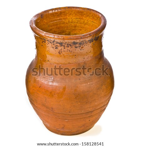 very old rustic clay jug of milk isolated on white background - stock photo