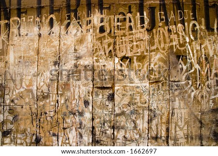 Very old scrawled graffiti words in the plaster of historic building. - stock photo