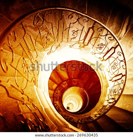Very old spiral stairway case - stock photo
