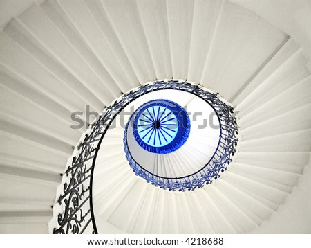 Very old spiral stairway case from below - stock photo