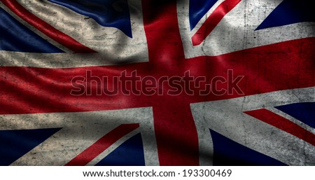Very old UK flag damaged over time - stock photo