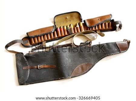 very old vintage sporting cartridge belt with shells and shotgun bag on white - stock photo