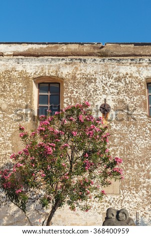 Very old walls of Saint Vincent Cathedral on Stromboli island, Aeolian Islands, Sicily, South Italy. - stock photo