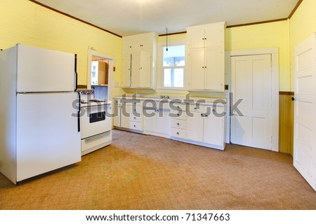 Very old white and yellow kitchen. Build in 1907 old farm house in Ashford, Washington State near Mt. Rainier. - stock photo