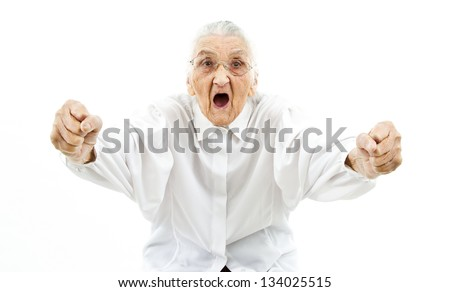 very old woman supporting something in a funny way - stock photo