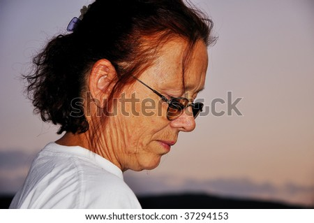 Very old woman with expression on her face - stock photo