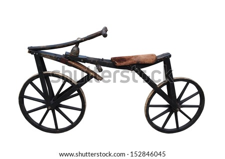Very old wooden bicycle isolated on white background