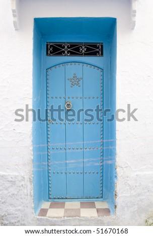 Very old wooden door of Morocco - stock photo