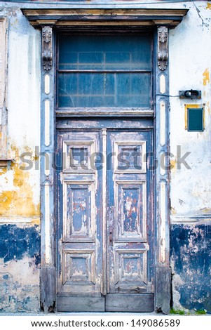 Very old wooden door painted in blue - stock photo