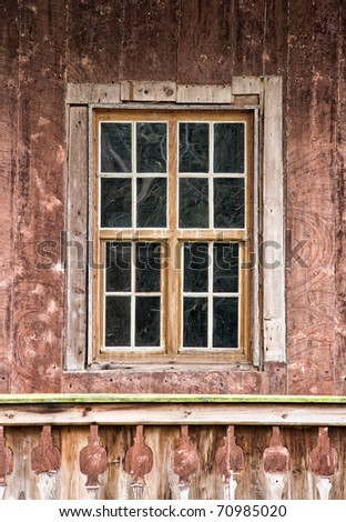 Very old wooden window in the wall of cottage - stock photo