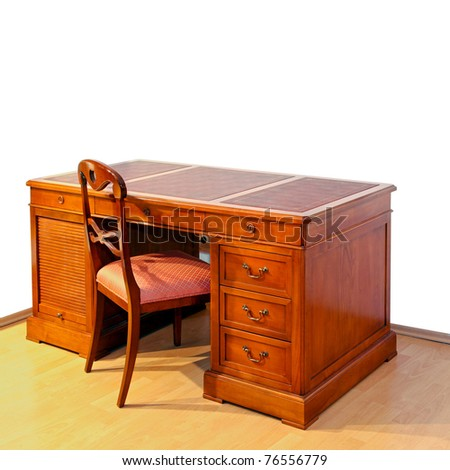 Very old wooden work desk with chair - stock photo