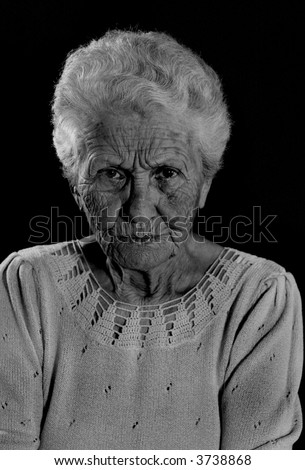 Very Old Wrinkled Woman With Stern Look on Her Face - stock photo
