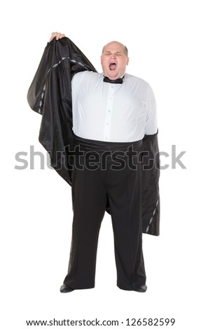 Very overweight elegant fat man yawning after a night out as he strips off his dinner jacket, studio portrait on white - stock photo
