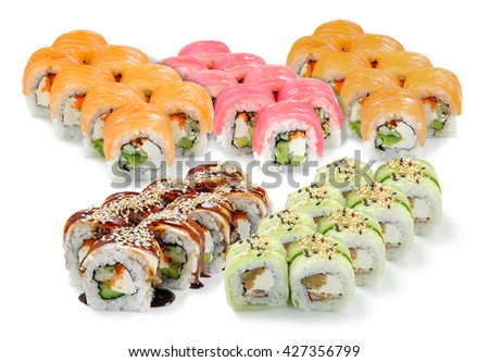 Very popular meal from Japan consists of the combination of the seafood and rice. Tasty rolls with soft cream cheese philadelphia, cucumber, salmon, tuna, perch and sesam. - stock photo