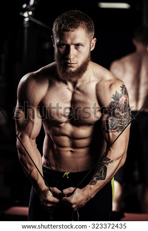 very power athletic guy bodybuilder , execute exercise - stock photo
