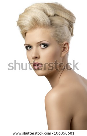 very pretty blonde woman with elegant hairstyle, she is turned of three quarters at right and looks in to the lens with serious expression - stock photo