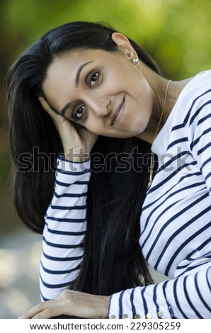 Very pretty Indian woman poses nicely for the camera - stock photo