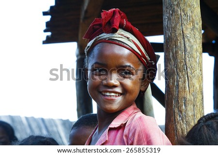 Very pretty malagasy child smiling in the vilage- poverty - stock photo