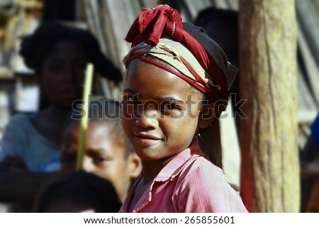 Very pretty malagasy child smiling in the village- poverty - stock photo