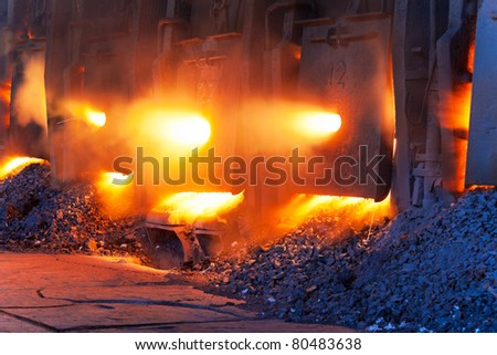 Very rare close view of working open hearth furnace at the metallurgical plant - stock photo