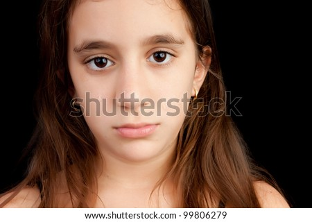 Very sad girl crying and looking at the camera isolated on black with space for text