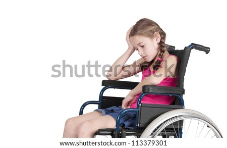 Very sad handicapped girl in a wheelchair - stock photo