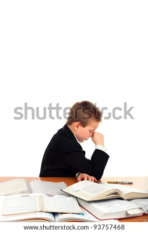 very sad schoolboy crying on the table isolated on the white background