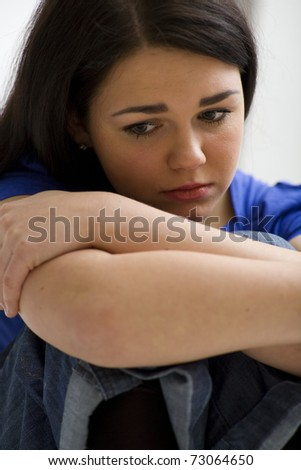 Very sad young woman - stock photo