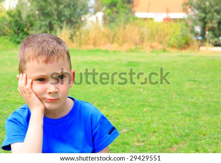 very serious boy - stock photo