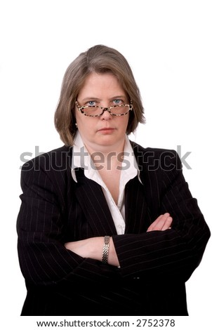 Very serious Female executive in business suit isolated on a white background background - stock photo