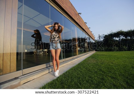 Very sexual and attractive girl. street fashion shooting. many colors. woman with great body and brown hair - stock photo
