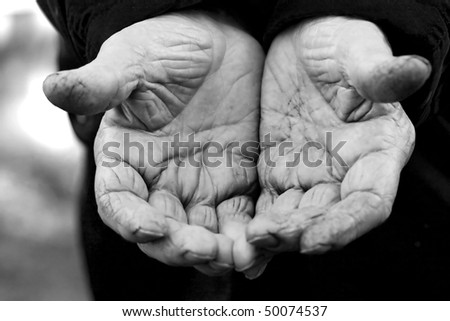 very short depth of field focused on cenrtral hand and wrinkles