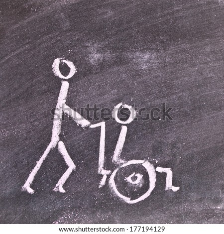 Very simple chalk sketch depicting a carer pushing a disabled person in a wheelchair - stock photo