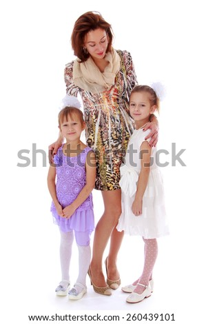 very slender and beautiful young mother with two lovely daughters - isolated on white. - stock photo