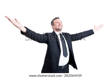 Very successful business man, banker, lawyer or accountant stretching arms wide open expressing independence, success, positivity and victory - stock photo