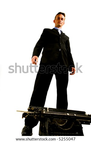 Very successful businessman with an ancient typewriter - stock photo