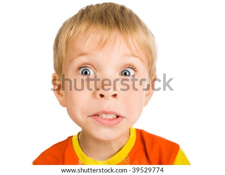very surprised five-year-old boy isolated on white background - stock photo