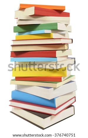Very tall stack of various books isolated on white  - stock photo