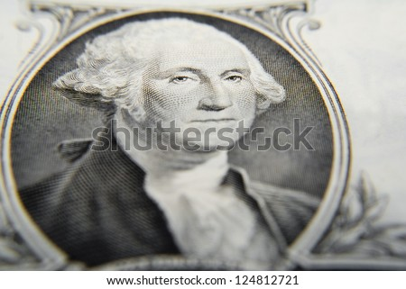 Very tight close-up on George Washington as printed on the one dollar bill, focus on the eyes. - stock photo