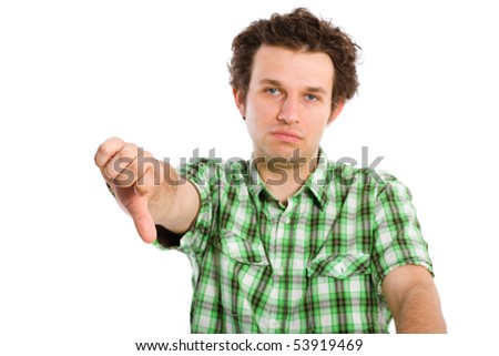 very unhappy young male, thumb down and face expression, isolated on white
