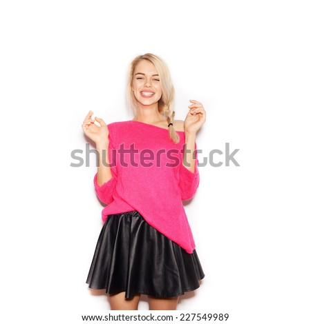 Very upset and emotional woman smiling  over white background, not isolated - stock photo