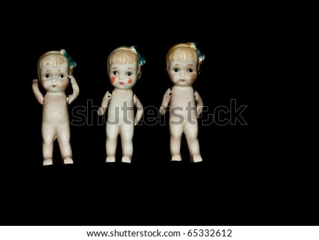 Very vintage ceramic dolls with articulating shoulder joints, black isolation. - stock photo