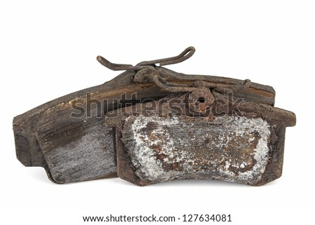 Very worn out brake pads threatening road safety - stock photo