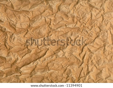 very wrinkled sheet of brown paper with rough texture