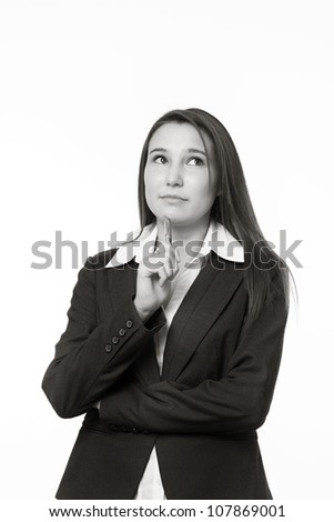 very young looking woman in a suit just starting out in business thinking how her future going to turn out - stock photo