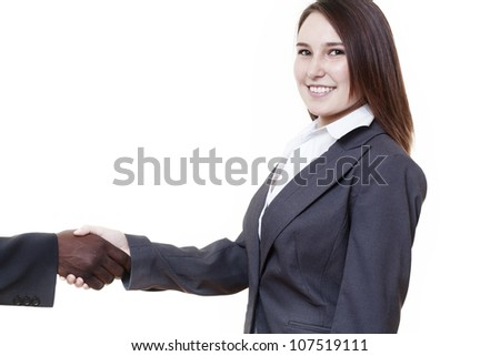 very young looking woman in a suit just starting out, trying to do well in business shaking hands with a african american man - stock photo