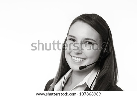 very young looking woman making a call on a head set - stock photo