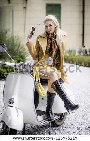 Vespa Vintage Girl - stock photo