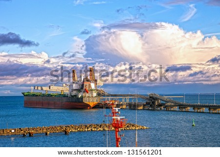 Vessel under coal loading in port Gdansk, Poland. - stock photo