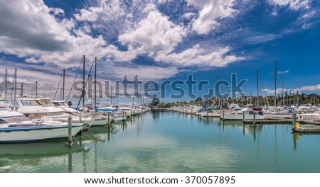 Vessels moored in Pine Harbor, Auckland, New Zealand - stock photo